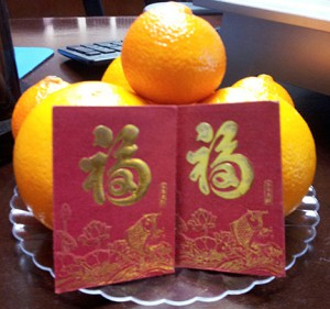 Oranges and money envelopes given for luck during the Lunar New Year.